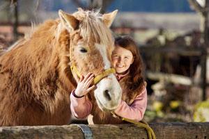 Glückliche Stunden mit dem Pferd